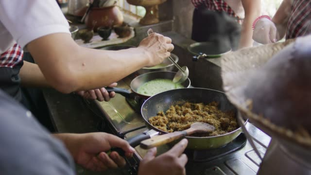 cooking traditional indonesian food - fatcamera stock videos & royalty-free footage