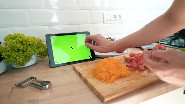 cooking using a digital tablet. - carota video stock e b–roll