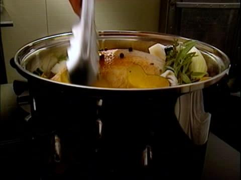 cooking - fleischzange stock-videos und b-roll-filmmaterial