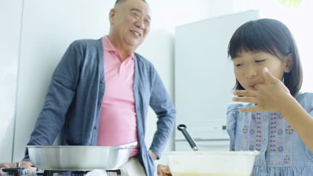 cooking with granddad - grandfather stock videos & royalty-free footage