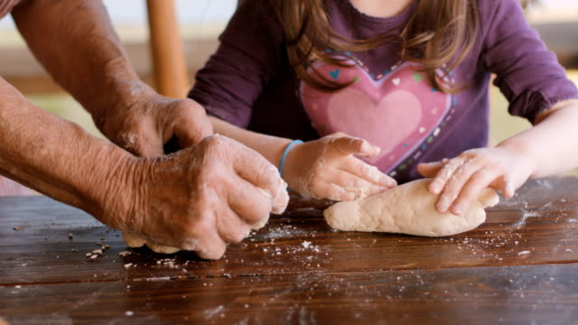 Cooking With Grandma-Beautiful Little Girl Learns How To Make Cookies  in The Bright-lit Vintage Kitchen
