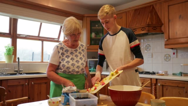 cooking with her grandson - grandmother stock videos & royalty-free footage