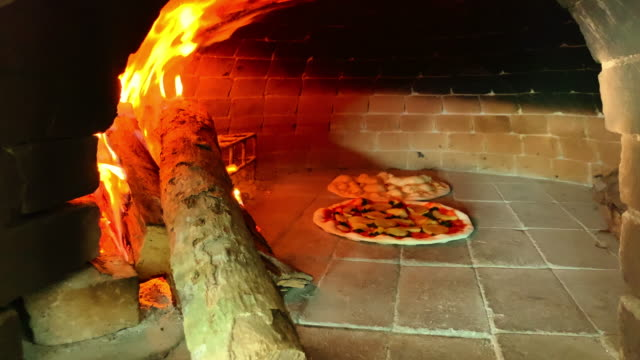 cooking wood fire pizza - pizza oven stock videos and b-roll footage