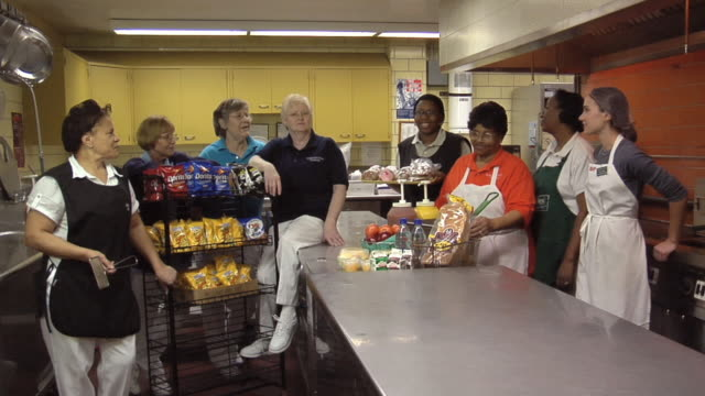 WS Cooks gathered inside school's kitchen after preparing and serving lunch to students / Belleville, Michigan, USA