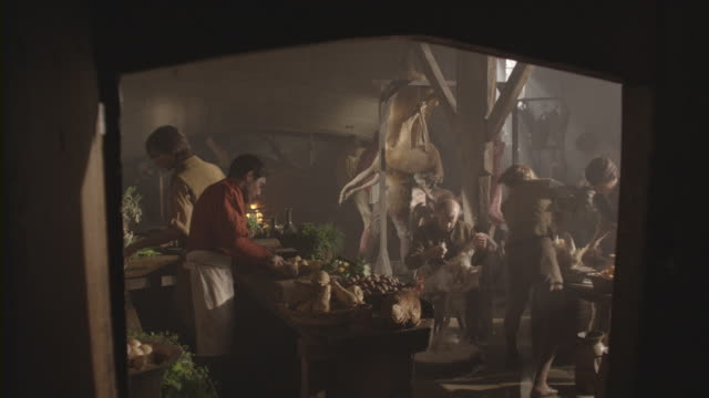cooks prepare dishes in an old-fashioned kitchen. - banquet stock videos & royalty-free footage