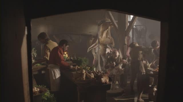 vídeos de stock e filmes b-roll de cooks prepare dishes in an old-fashioned kitchen. - banquete