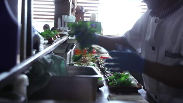 cooks preparing mezze dishes in a lebanese restaurant. - kitchen stock videos & royalty-free footage