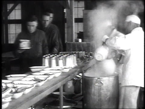 stockvideo's en b-roll-footage met ms cooks serving food from behind mess counter men lining up with plates / chillicothe ohio united states - chillicothe