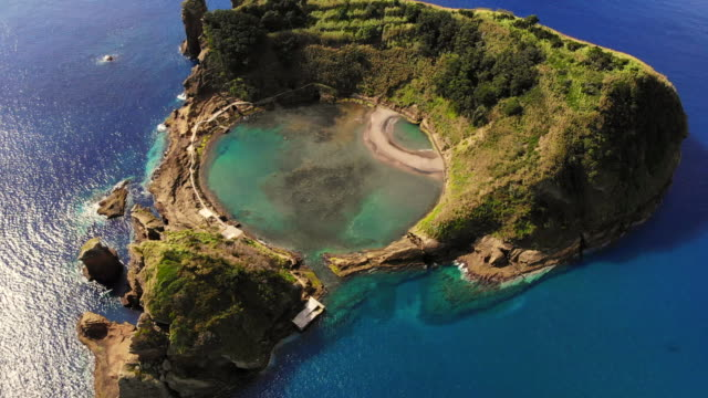 cool aerial view of circle pool inside volcanic island with eye shape in the azores islands. - atlantic islands stock videos & royalty-free footage