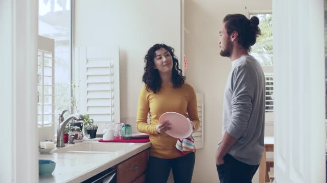ws cool couple doing dishes together - domestic kitchen stock videos & royalty-free footage