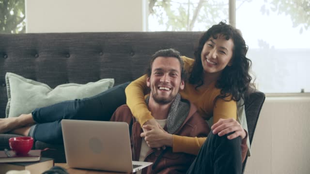 ms cool couple hanging out at home together - guardare in una direzione video stock e b–roll