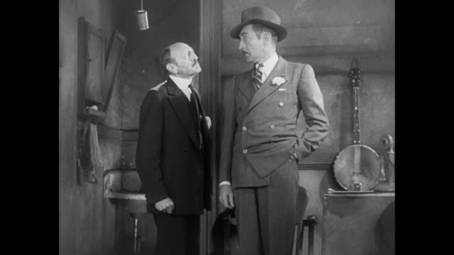 vidéos et rushes de 1931 cool editor (adolph menjou) brushes off frustrated sheriff - 1931