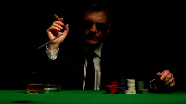 cool gambler playing poker in sunglasses - poker card game stock videos and b-roll footage