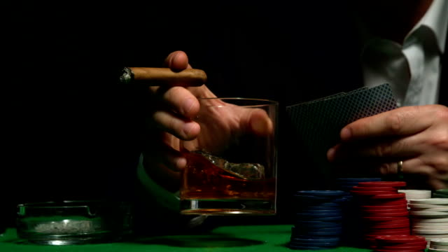 cool gambler swirling glass of whiskey - poker card game stock videos and b-roll footage