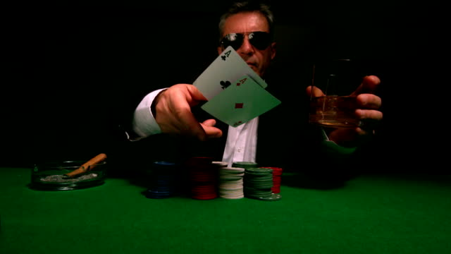 cool gambler throwing cards to camera - poker card game stock videos and b-roll footage