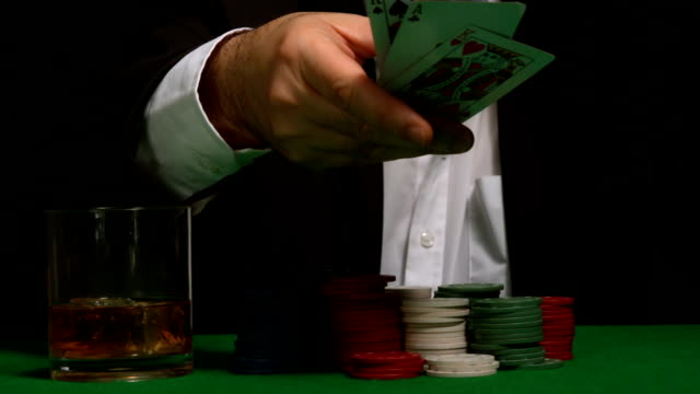 Cool gambler throwing down his poker hand