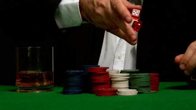 cool gambler throwing red dice - dice stock videos & royalty-free footage