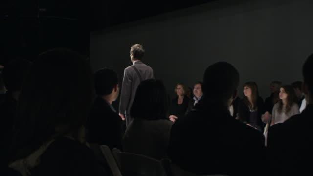 stockvideo's en b-roll-footage met ms ds pan cool geek walking down runway a fashion show  - catwalk toneel