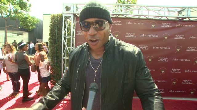 cool j on what brought him to the event why stuart house is important and why it's important to provide services to these children what he's looking... - ll cool j stock videos and b-roll footage