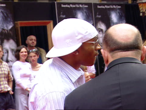 cool j white ny yankees cap sunglasses standing on red carpet near radio city music hall talking to press male reporter - radio city music hall stock videos and b-roll footage