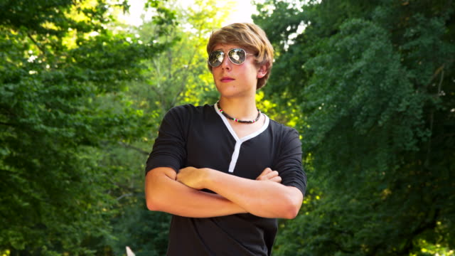 ms ds cool teenage boy with sunglasses - teenage boys stock videos & royalty-free footage