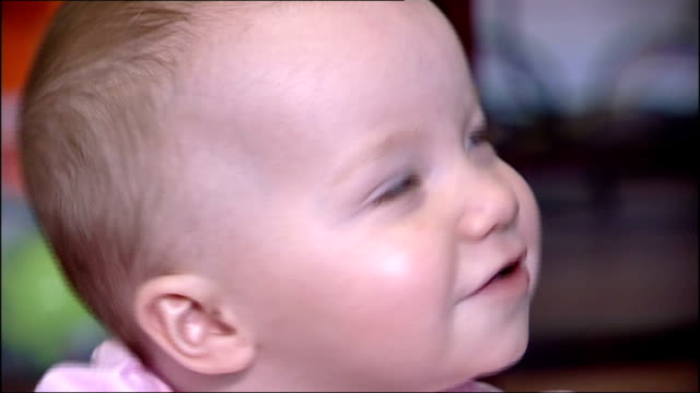 cooled baby survives without brain damage england int close up of smiling baby ella anderson - brain damage stock videos & royalty-free footage