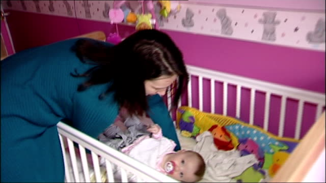 cooled baby survives without brain damage rachel claxton carrying ella along as puts her in cot close up of ella - brain damage stock videos & royalty-free footage