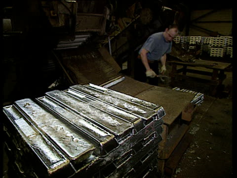 cooled ingots of recycled aluminum being stacked into piles - aluminium stock videos & royalty-free footage