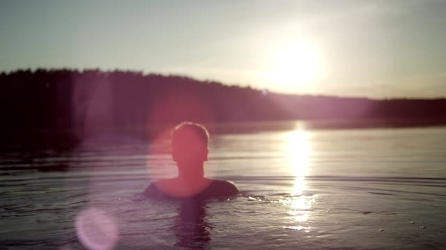 cooling off in the lake. sunset - taking a bath stock videos & royalty-free footage