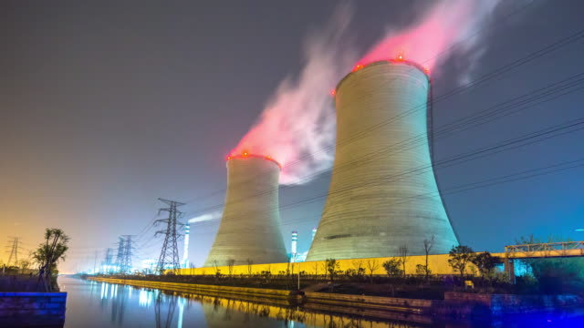 cooling tower with beautiful smoke near river at night. timelapse 4k - nuclear power station stock videos & royalty-free footage