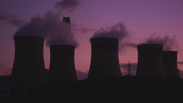 cooling towers at power station during sunset - purple stock videos & royalty-free footage