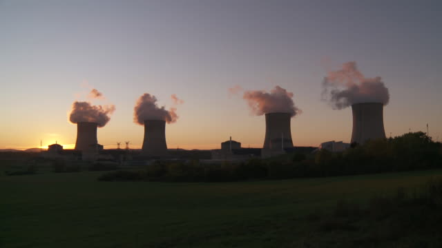 ws cooling towers of power station against sunset / cattenom, lorraine mosel, france - lorraine stock videos & royalty-free footage