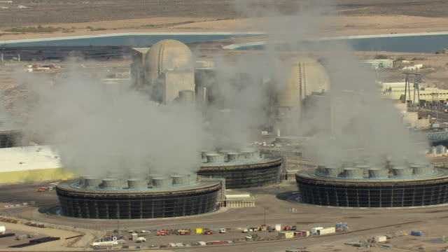 ms aerial zi cooling towers with smoke coming out at palo verde nuclear generating station / tonopah, arizona, united states  - kernenergie stock-videos und b-roll-filmmaterial