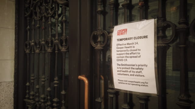 "cooper hewitt closed sign by the entrance during coronavirus pandemic. closeup on sign which reads ""temporary closure. [...] to support the effort to... - museum stock videos & royalty-free footage"