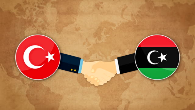 cooperation between turkey and libya. ready handshake with flags background. cartoon animation - red tape stock videos & royalty-free footage