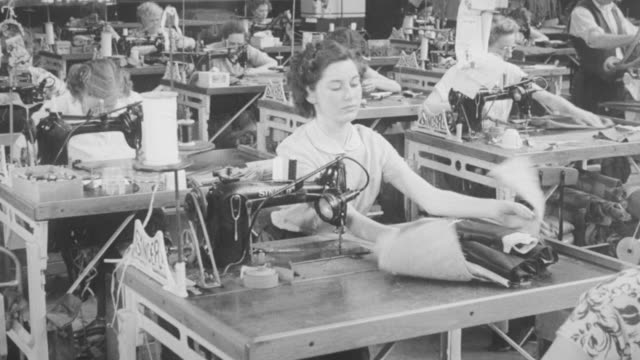 1948 montage cooperative members working in a clothing factory / northamptonshire, england, united kingdom - 1948 stock-videos und b-roll-filmmaterial
