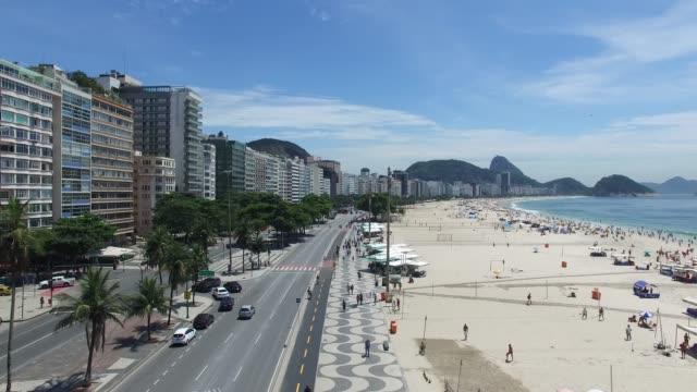 copacabana beach in rio de janeiro, brazil - rio de janeiro stock videos & royalty-free footage
