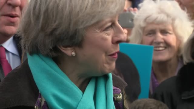 theresa may visit copeland byelection theresa may visit england cumbria copeland whitehaven ext close shot trudy harrison rosette / theresa may mp... - cumbria stock-videos und b-roll-filmmaterial