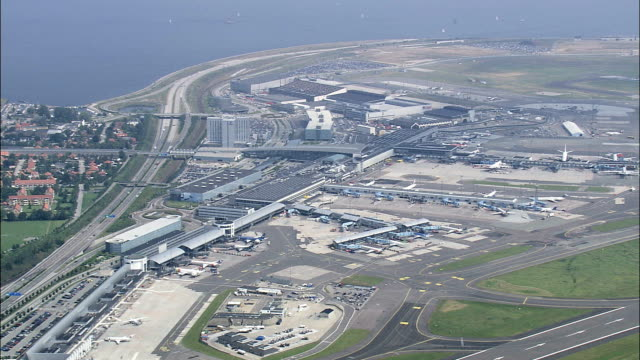 copenhagen airport  - aerial view - capital region, tårnby kommune, denmark - capital region stock videos and b-roll footage