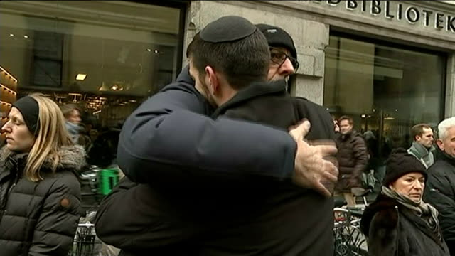 memorial services held / 2 men arrested ext jair melchior along and hugging man then away - regione dell'oresund video stock e b–roll