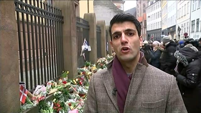 memorial services held / 2 men arrested reporter to camera - öresundregion stock-videos und b-roll-filmmaterial