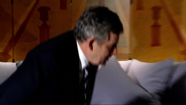talks get bogged down denmark copenhagen gordon brown mp sitting talking with meles zenawi brown and zenawi handshake gordon brown mp interview sot... - oresund region stock videos & royalty-free footage