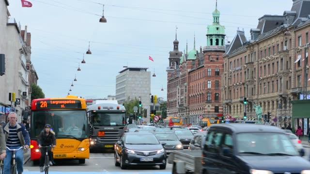 copenhagen denmark downtown traffic and bikes in street  kobenhavn - copenhagen stock videos and b-roll footage