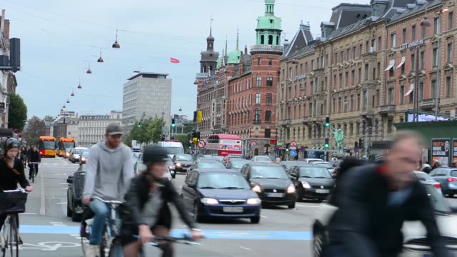 copenhagen denmark downtown traffic and bikes in street  kobenhavn - denmark stock videos & royalty-free footage