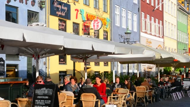 copenhagen denmark famous nyhavn color homes and boats with crowds kobenhavn tourists - pavement cafe stock videos & royalty-free footage