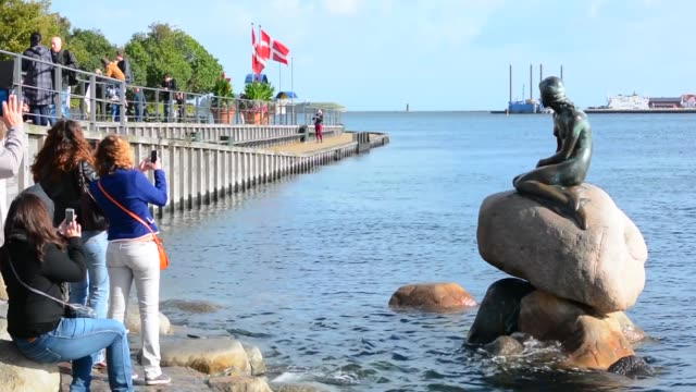 Copenhagen Denmark Little Mermaid monument Den Lille Havfrue with tourists Kobenhavn