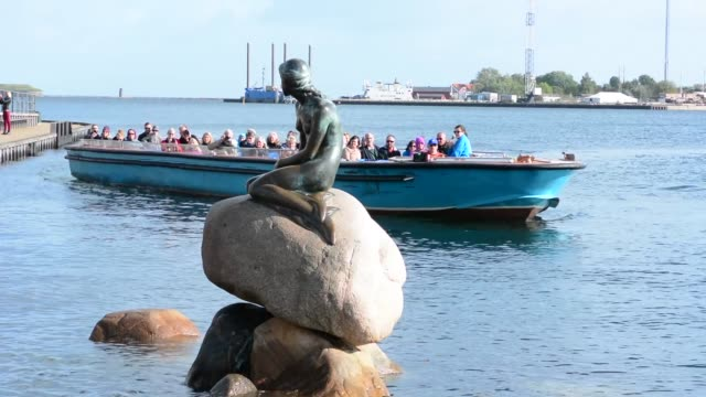 Copenhagen Denmark Little Mermaid monument Den Lille Havfrue with tourists boat Kobenhavn