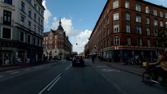 copenhagen nørrebro ix synced series front view driving process plate - car point of view stock videos & royalty-free footage