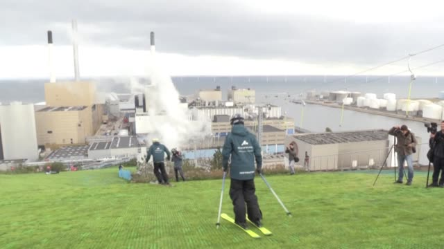 copenhill the world's first ski slope on a waste incinerator is inaugurated facing the sea in copenhagen capital of denmark one of the flattest... - copenhagen video stock e b–roll