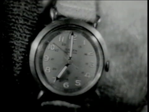stockvideo's en b-roll-footage met co-pilot & pilot checking watches, watch face of guren wristwatch, almost 7:00, same second watch, second hand moving. same third watch, seconds... - 40 seconds or greater